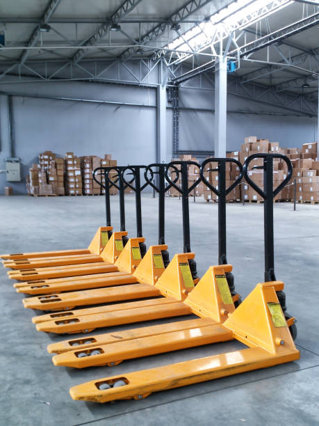 Yellow Hand Pallet Trucks Couple of yellow hand pallet trucks in the warehouse pallet jack stock pictures, royalty-free photos & images