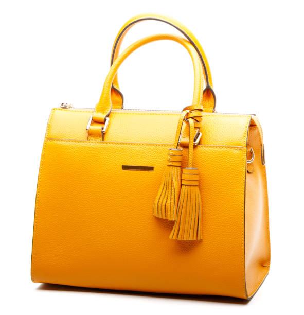 gele handtas - handtas stockfoto's en -beelden