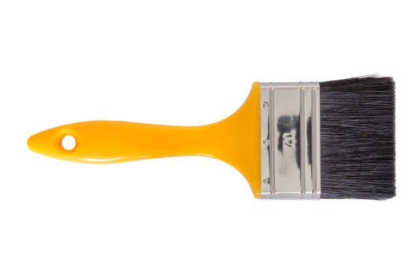 Yellow handled paintbrush isolated Yellow handled paintbrush cut out on a white background. Tools series. paintbrush stock pictures, royalty-free photos & images