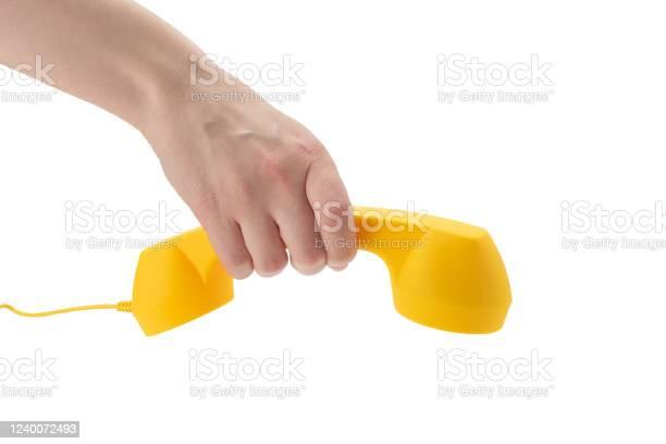 Yellow handset in woman hand isolated on white picture id1240072493?b=1&k=6&m=1240072493&s=612x612&h=qzsrbpc m  ieig9mw8zeeoliuxmtgqzdfg5xpfasb4=