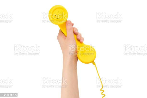 Yellow handset in woman hand isolated on white picture id1241618710?b=1&k=6&m=1241618710&s=612x612&h=f rw95fzom8cdvfroinlxki8fl354ydg8zxhmcksic0=