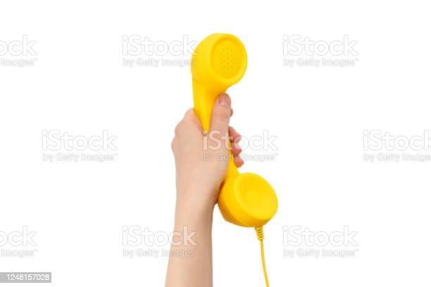 Yellow handset in woman hand isolated on white picture id1248157028?b=1&k=6&m=1248157028&s=612x612&h=tvnrvygnool vscezifniniifpfw33kbfxf91hm02es=