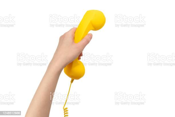 Yellow handset in woman hand isolated on white picture id1248512666?b=1&k=6&m=1248512666&s=612x612&h=ro29d insxz0kl0enyyqsjl6rdkai4qco4qv29o91js=