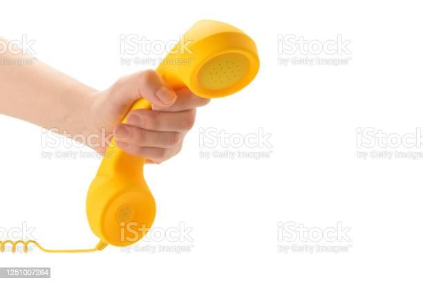 Yellow handset in woman hand isolated on white picture id1251007264?b=1&k=6&m=1251007264&s=612x612&h=wsll ccvmdncy2ttjxazjqaotdb3fbwe8rckzxjxxko=