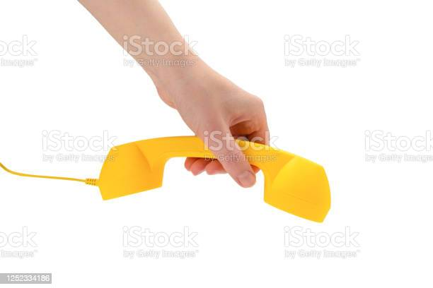 Yellow handset in woman hand isolated on white picture id1252334186?b=1&k=6&m=1252334186&s=612x612&h=eajkzeij3w8lea5v9ng7kdenqa2hzxnqrig2tuojlme=