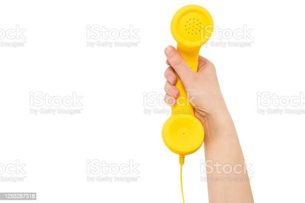 Yellow handset in woman hand isolated on white picture id1253287318?b=1&k=6&m=1253287318&s=612x612&h=pkdshqaotyxwu166j6yudiyqydeflfx3ta5jmcivn0u=