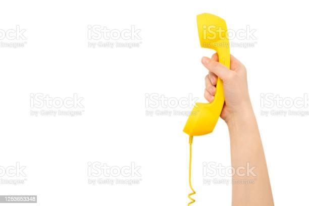 Yellow handset in woman hand isolated on white picture id1253653348?b=1&k=6&m=1253653348&s=612x612&h=yjl6zrnhjvq9mom4ioytd8jcqbk5ptohmmmjo sg27i=