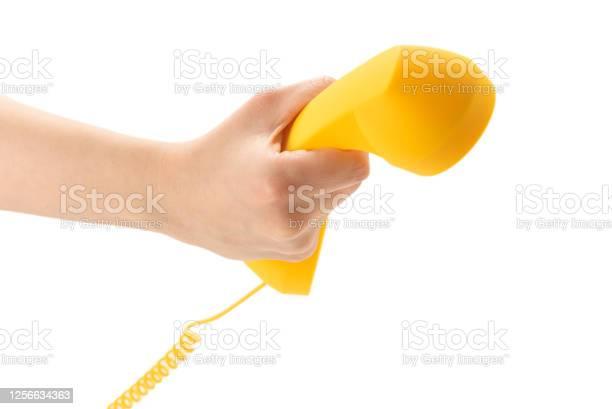 Yellow handset in woman hand isolated on white picture id1256634363?b=1&k=6&m=1256634363&s=612x612&h=m82swf8np7oinovgh4sdvk81q4ci2koyj ckvldzfxw=
