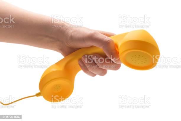 Yellow handset in woman hand isolated on white picture id1257071007?b=1&k=6&m=1257071007&s=612x612&h=iej6tjorxr1bjijyucaotsahm1y6yktwsw5wlv26nqw=