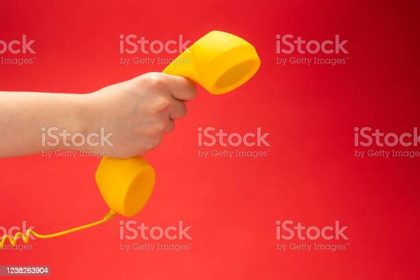 Yellow handset on a red background in woman hand picture id1238263904?b=1&k=6&m=1238263904&s=612x612&h=fdlm8xq6njkfgh grrf784q9kasxptrtfdf7pyilos4=