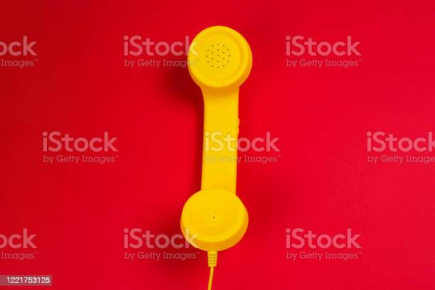 Yellow handset on red background picture id1221753125?b=1&k=6&m=1221753125&s=612x612&h=ix7mfuzop dutavt8m6n4jiur4jgu7bxmqhizfmn7se=