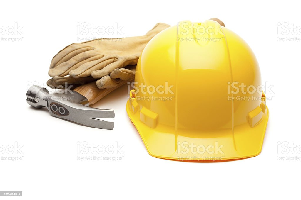 Yellow Hard Hat, Gloves and Hammer on White royalty-free stock photo