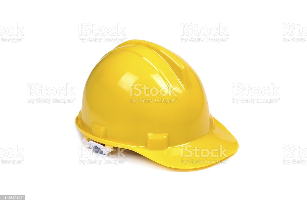 A yellow hard hat on a white background stock photo