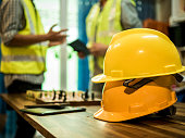 istock Yellow hard safety helmet hat for safety project of workman as engineer or worker, In the office, safety concept 1160810646