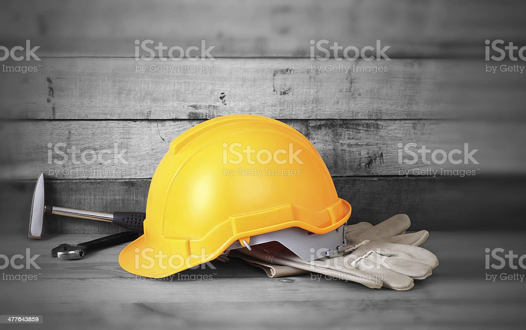 Yellow hardhat and leather gloves royalty-free stock photo