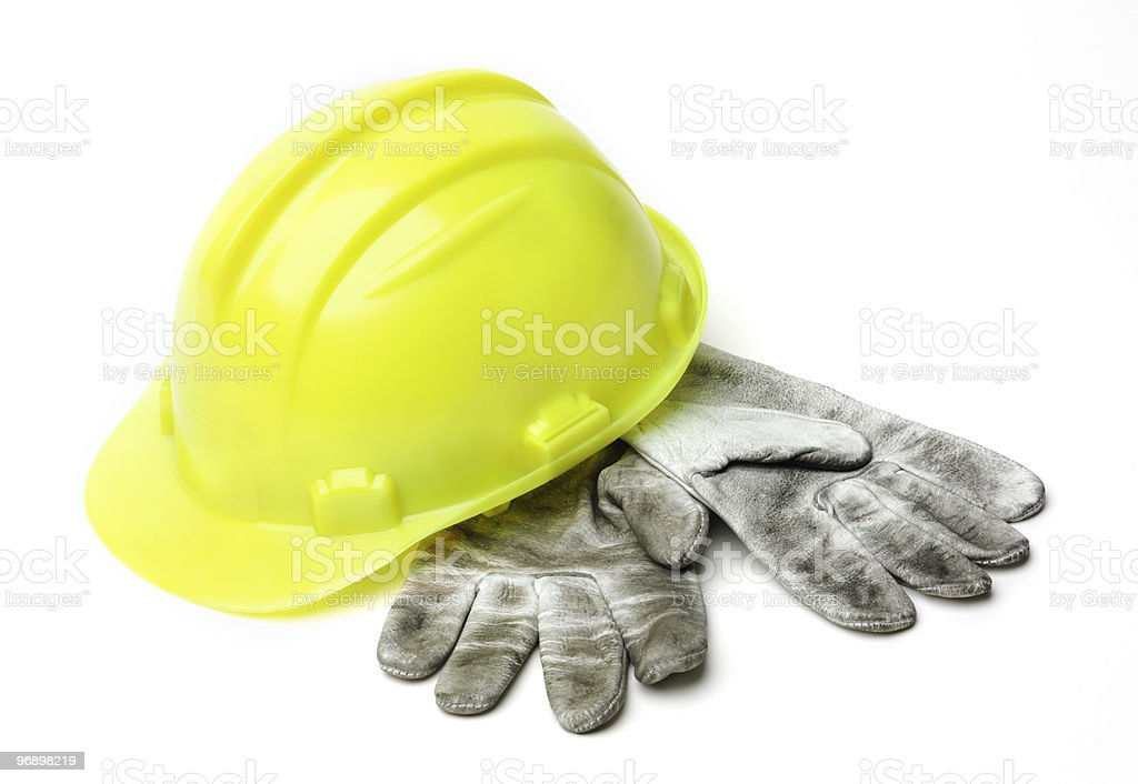 Yellow hardhat and old gloves royalty-free stock photo