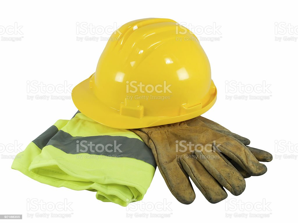 Yellow hardhat, old leather gloves and reflective vest stock photo