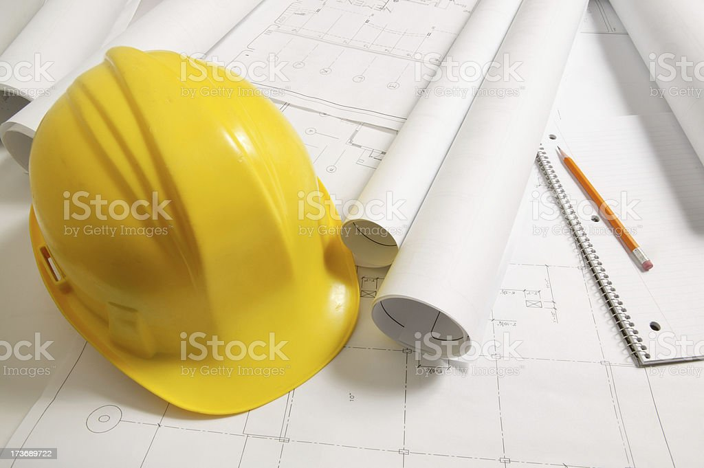 yellow hardhat with blueprint royalty-free stock photo
