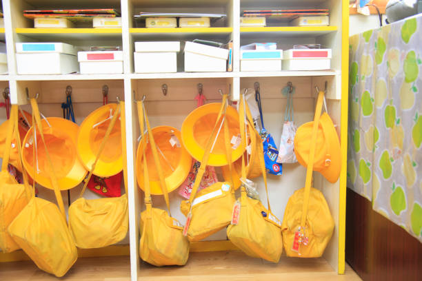 yellow hat - preschool building stock photos and pictures