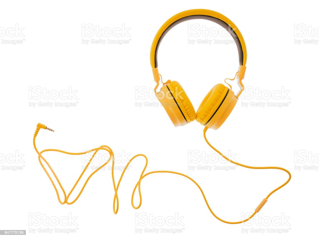yellow headphones or earphone computer isolated on a white background стоковое фото