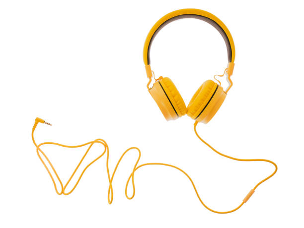 yellow headphones or earphone computer isolated on a white background stock photo