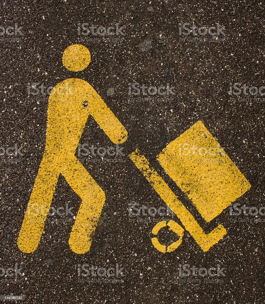 Yellow heaver sign on black asphalt stock photo