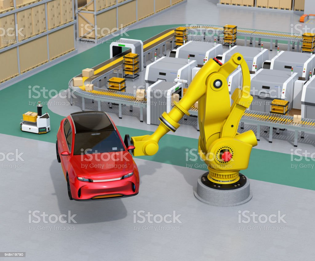 Yellow heavyweight robotic arm carrying red SUV in the assembly factory stock photo