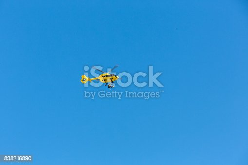 istock Yellow helicopter used for rescue operations, Medical rescue helicopter flying rescue injured climber on the Tre Cime. Italy, Dolomites 838216890