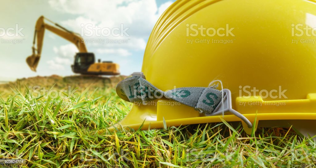 Yellow helmet and at construction site stock photo