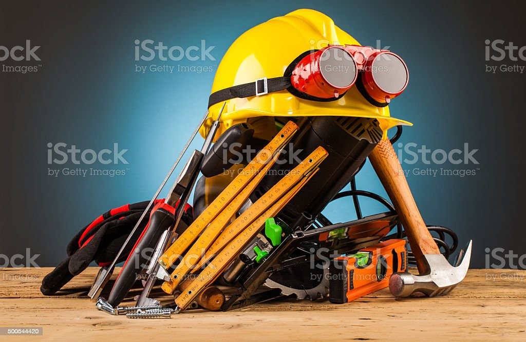 yellow helmet and wood mounting tools stock photo