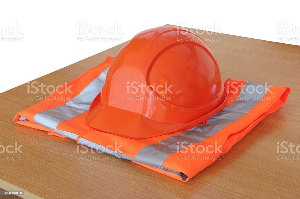 yellow high visibility vest and protective helmet stock photo