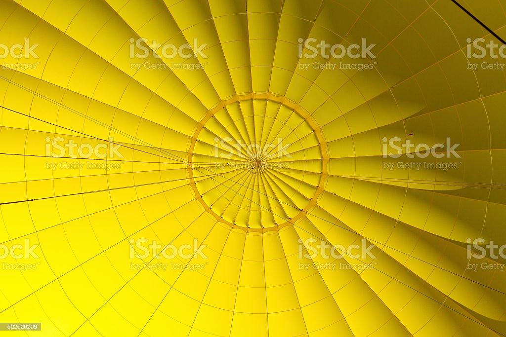 Yellow hot air balloon stock photo