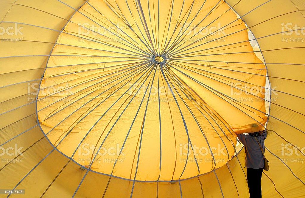 Yellow hot air balloon Swiss alps royalty-free stock photo