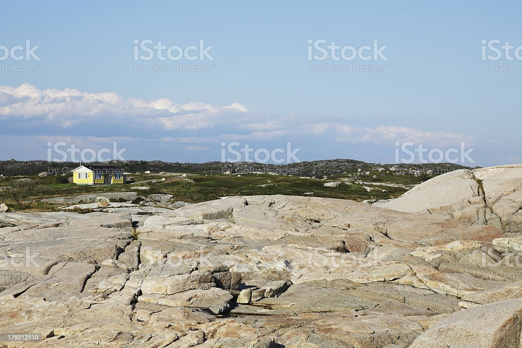 Yellow House on the Peggy's Cove Rocks royalty-free stock photo