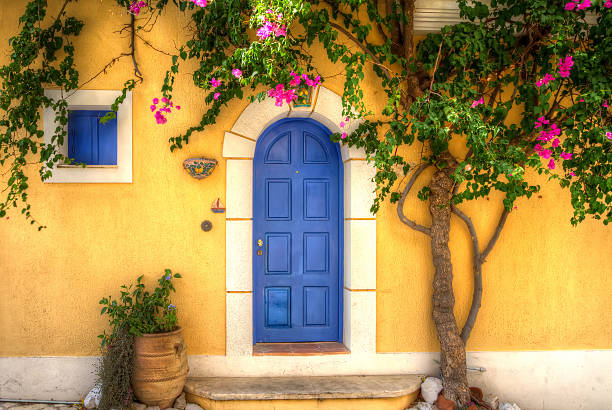 Yellow house with Blue Door stock photo