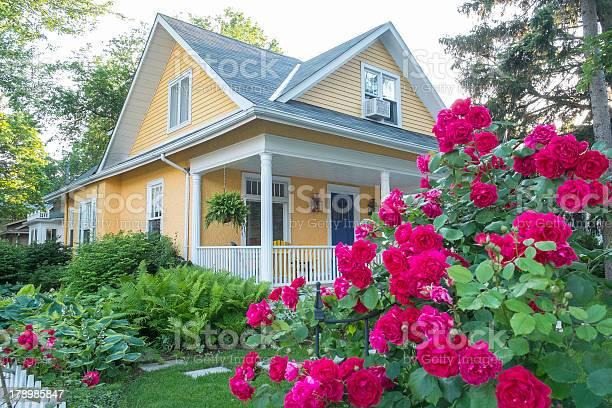 Yellow house with pink flowers picture id178985847?b=1&k=6&m=178985847&s=612x612&h=tmqvv6zolngiemzlw7vzybn18yy4pkdwj2h6z14jiw4=