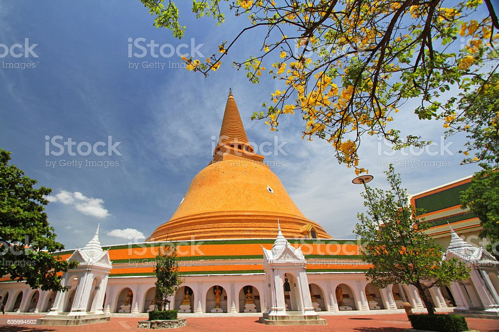 Yellow huge pagoda with flower foreground stock photo
