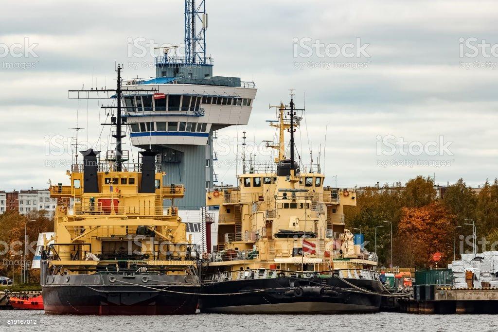 Yellow icebreakers moored stock photo