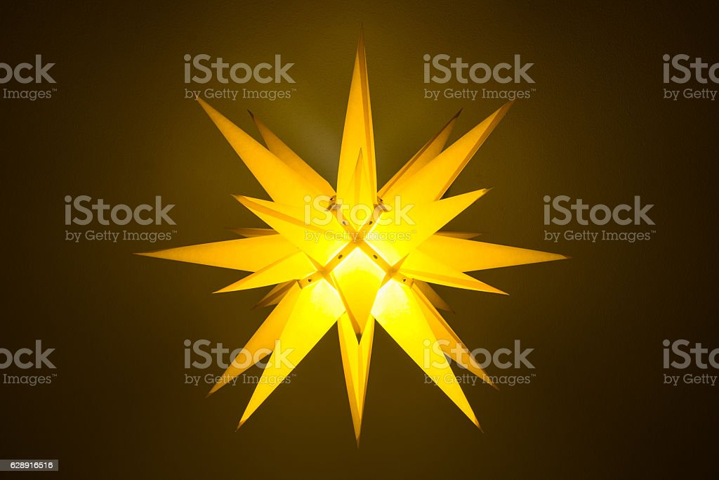 Yellow illuminated moravian star stock photo
