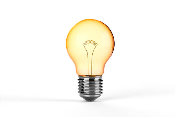yellow incandescent light bulb - isolated - light bulb stock pictures, royalty-free photos & images