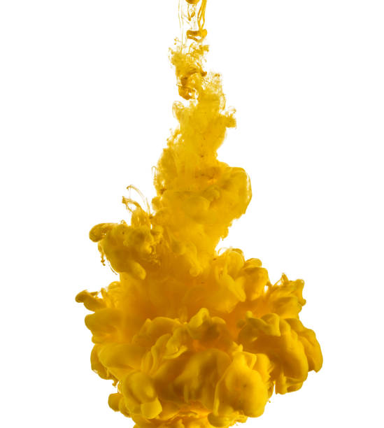 yellow ink drop flowing in water - yellow stock photos and pictures