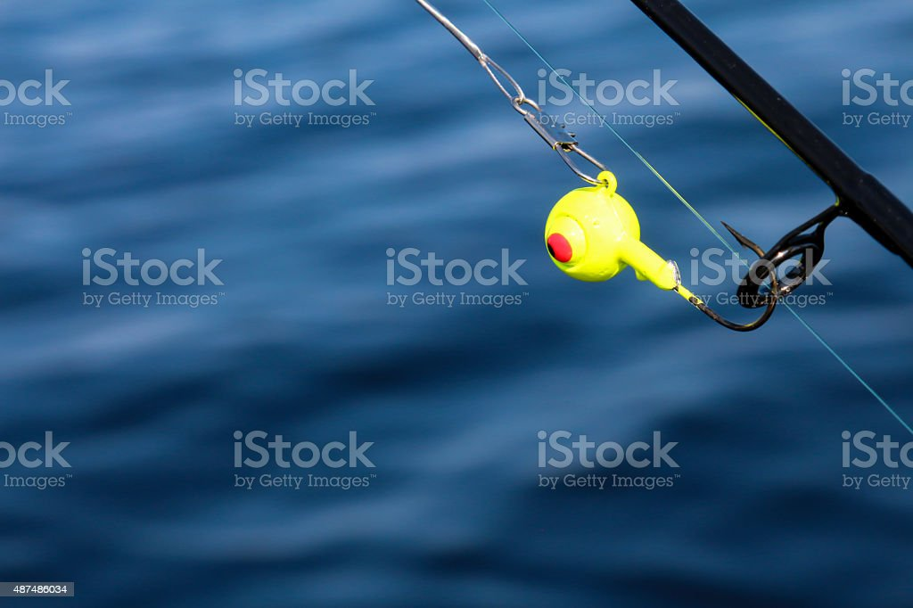 Yellow jig head with red eye fishing tackle on pole stock photo