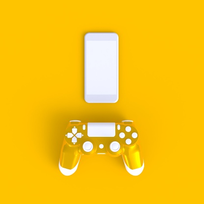istock Yellow joystick with smart phone on yellow table background, Computer game competition, Gaming concept, 3D rendering 971964110