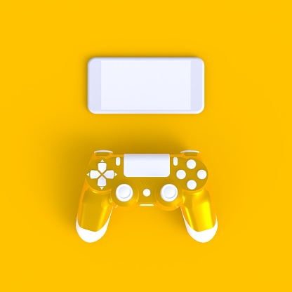 istock Yellow joystick with smart phone on yellow table background, Computer game competition, Gaming concept, 3D rendering 978957886