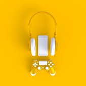 istock Yellow joystick with yellow headphones and smart phone on yellow table background, Computer game competition, Gaming concept, 3D rendering 1011714932