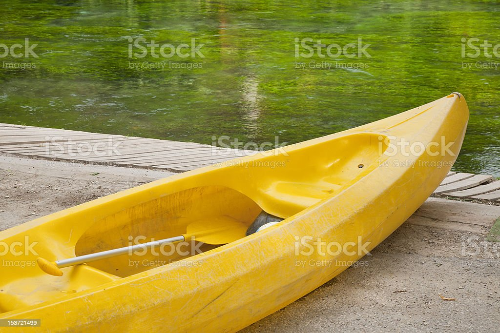 Yellow Kayak Green Water stock photo