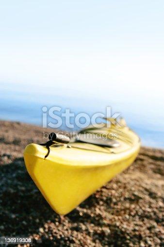 184332102istockphoto XXL yellow kayak on beach 136919308