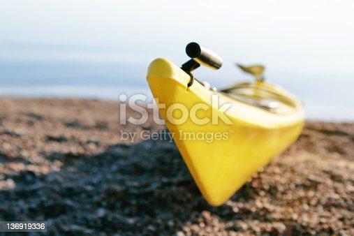184332102istockphoto XXL yellow kayak on beach 136919336