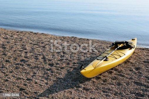 184332102istockphoto XXL yellow kayak on beach 136919339