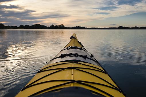 yellow kayak on small Ploner lake, river Schwentine, germany